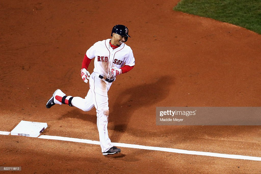 <a gi-track='captionPersonalityLinkClicked' href=/galleries/search?phrase=Mookie+Betts&family=editorial&specificpeople=12732023 ng-click='$event.stopPropagation()'>Mookie Betts</a> #50 of the Boston Red Sox rounds third on his way to score after hitting a two-run homer during the second inning against the Tampa Bay Rays at Fenway Park on April 20, 2016 in Boston, Massachusetts.