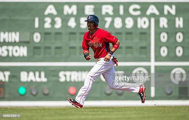 Mookie Betts of the Boston Red Sox runs against the Minnesota Twins on March 7 2015 at JetBlue Park in Fort Myers Florida
