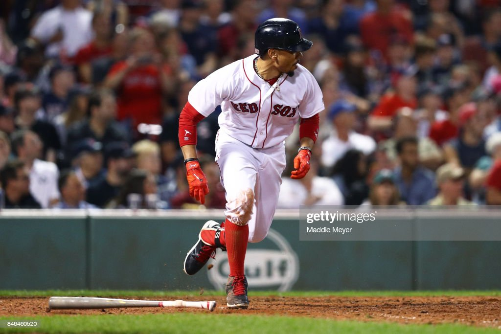 Mookie Betts #50 of the Boston Red Sox runs for first base during the eighth inning against the Oakland Athletics at Fenway Park on September 12, 2017 in Boston, Massachusetts.