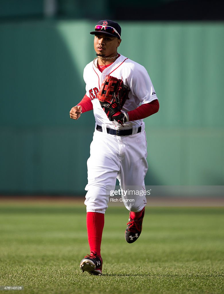 Mookie Betts #50 of the Boston Red Sox runs off the field during the fifth inning against the Oakland Athletics at Fenway Park on June 6, 2015 in Boston, Massachusetts. The Red Sox won 4-2.