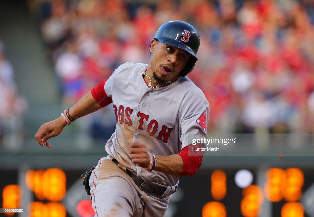 Mookie Betts #50 of the Boston Red Sox runs to third base in the second inning during a game against the Philadelphia Phillies at Citizens Bank Park on June 14, 2017 in Philadelphia, Pennsylvania. The Red Sox won 7-3.