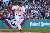 Mookie Betts of the Boston Red Sox runs towards first during the third inning at Fenway Park on April 13 2015 in Boston Massachusetts