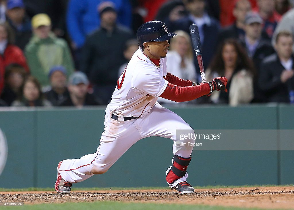 Mookie Betts #50 of the Boston Red Sox singles in the winning run in the ninth inning against the Toronto Blue Jays at Fenway Park April 27, 2015 in Boston, Massachusetts.