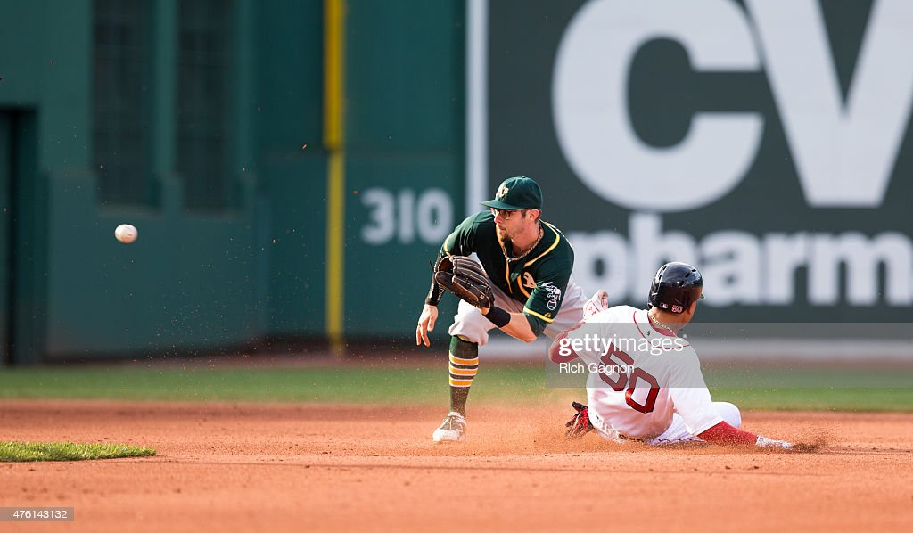 Mookie Betts #50 of the Boston Red Sox steals second base during the sixth inning gainst the Oakland Athletics at Fenway Park on June 6, 2015 in Boston, Massachusetts. The Red Sox won 4-2.
