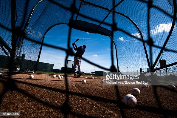 Mookie Betts of the Boston Red Sox takes batting practice during a Spring Training workout at Fenway South on February 21 2015 in Fort Myers Florida