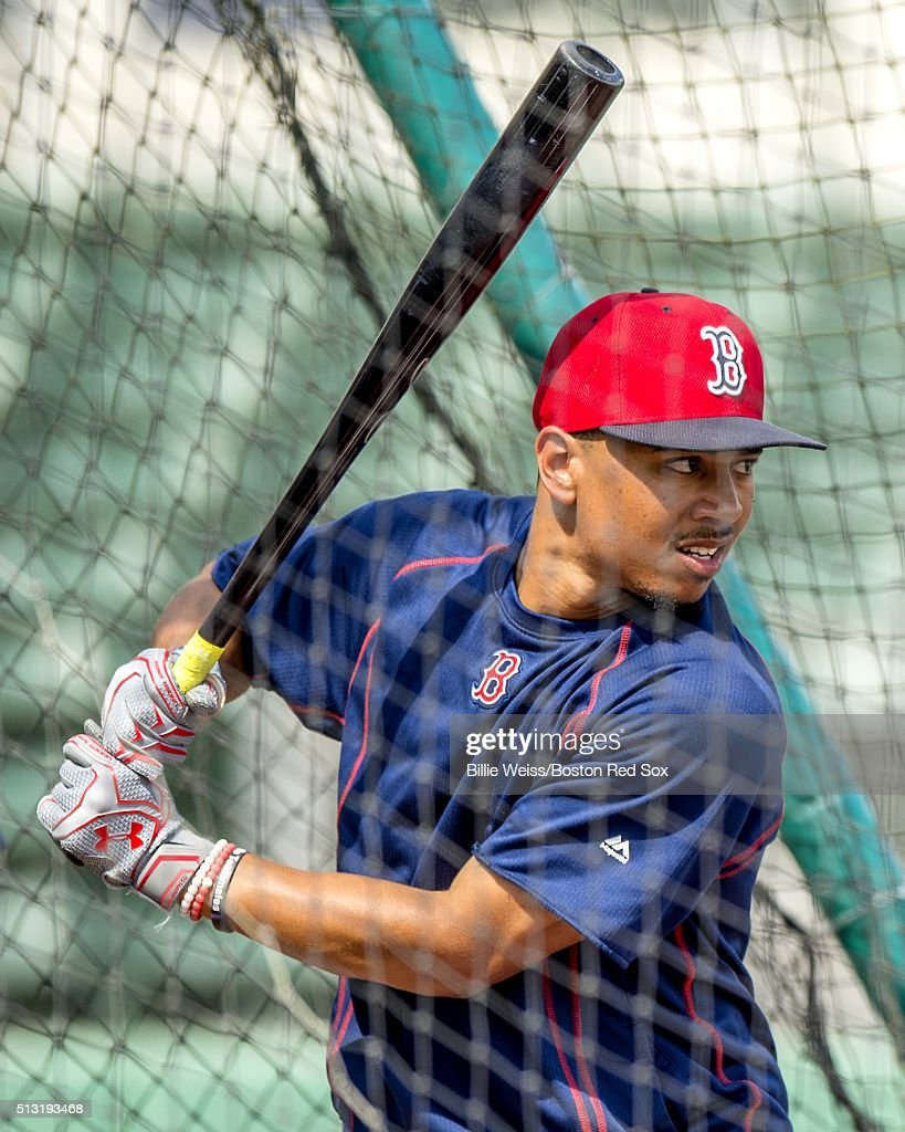 Mookie Betts #50 of the Boston Red Sox takes batting practice during a team workout on March 1, 2016 at Fenway South in Fort Myers, Florida .