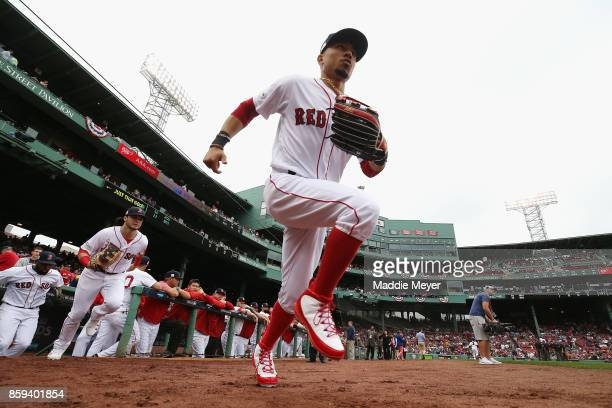 Mookie Betts of the Boston Red Sox takes the field before game four of the American League Division Series between the Houston Astros and the Boston...