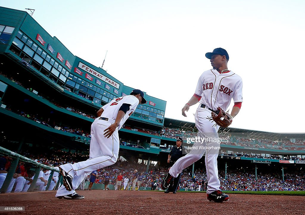 <a gi-track='captionPersonalityLinkClicked' href=/galleries/search?phrase=Mookie+Betts&family=editorial&specificpeople=12732023 ng-click='$event.stopPropagation()'>Mookie Betts</a> #50 of the Boston Red Sox takes the field in the first inning against the Chicago Cubs during the interleague game at Fenway Park on June 30, 2014 in Boston, Massachusetts.