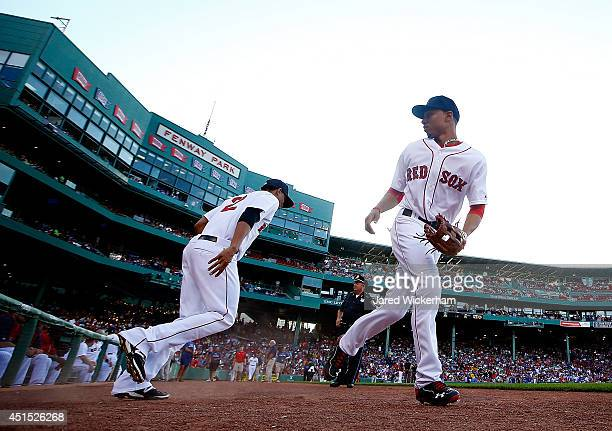 Mookie Betts of the Boston Red Sox takes the field in the first inning against the Chicago Cubs during the interleague game at Fenway Park on June 30...