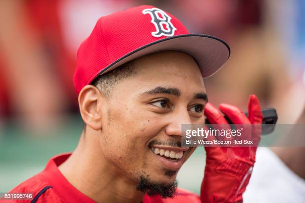 Mookie Betts of the Boston Red Sox talks on the phone before a game against the St Louis Cardinals on August 15 2017 at Fenway Park in Boston...