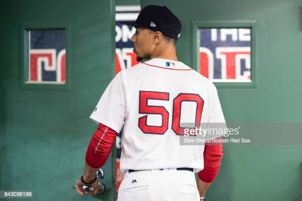 Mookie Betts of the Boston Red Sox walks out of the batting cage before a game against the Toronto Blue Jays on September 5 2017 at Fenway Park in...