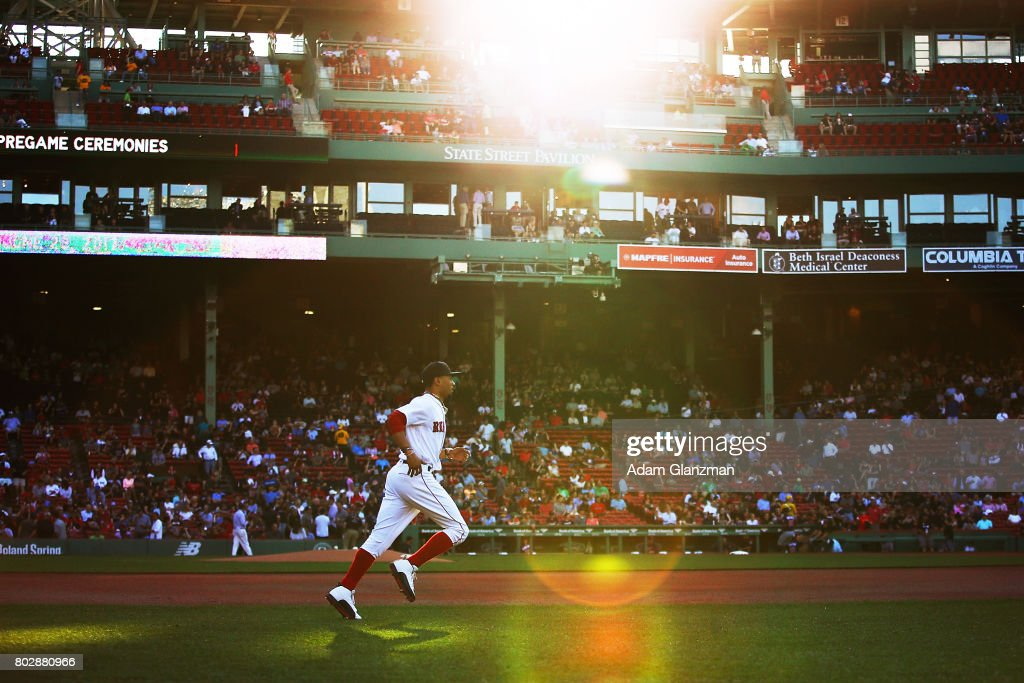 Mookie Betts #50 of the Boston Red Sox warms up before a game against the Minnesota Twins at Fenway Park on June 28, 2017 in Boston, Massachusetts.