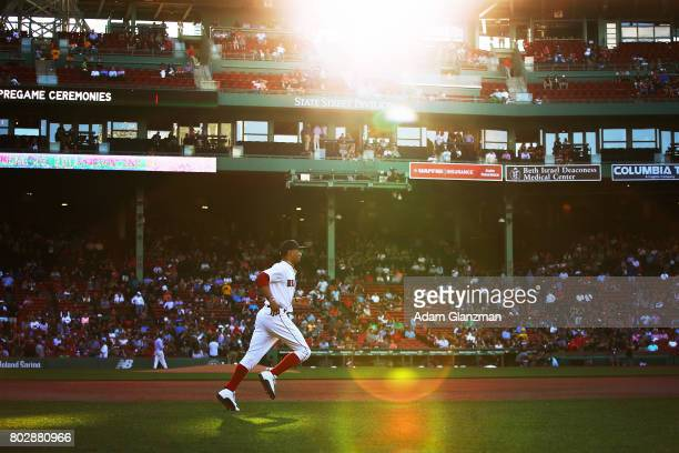 Mookie Betts of the Boston Red Sox warms up before a game against the Minnesota Twins at Fenway Park on June 28 2017 in Boston Massachusetts