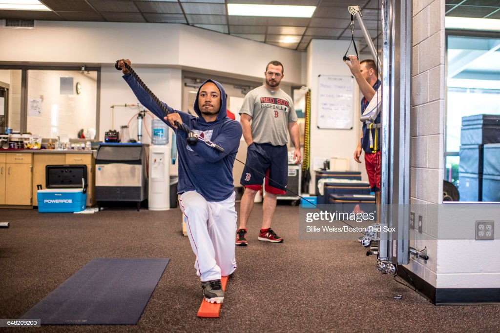 Mookie Betts #50 of the Boston Red Sox warms up in the weight room before a Spring Training game against the New York Yankees on February 28, 2017 at Fenway South in Fort Myers, Florida .