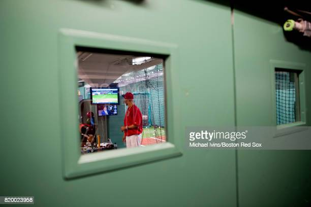 Mookie Betts of the Boston Red Sox watches a baseball game in the batting cage before a game against the Toronto Blue Jays at Fenway Park on July 18...
