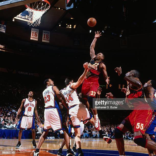 Mookie Blaylock of the Atlanta Hawks shoots over Chris Dudley of the New York Knicks in Game Three of the Eastern Conference Semifinals during the...