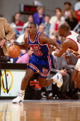 Mookie Blaylock of the New York Knicks dribbles around Terry Porter of the Portland Trailblazers during a game played in 1992 at the Veterans...
