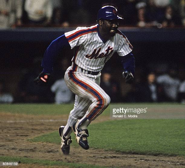 Mookie Wilson of the New York Mets runs to first base during Game 6 of the 1986 World Series against the Boston Red Sox in Shea Stadium on October 25...