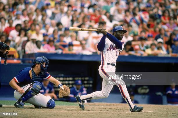 Mookie Wilson of the New York Mets swings at the pitch during a 1984 season game against the Chicago Cubs at Shea Stadium in Flushing New York