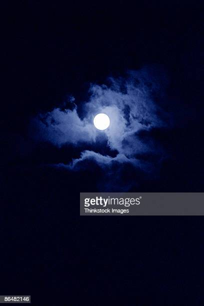 Moon and clouds in night sky