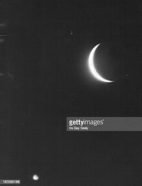 1966 MAR 14 1967 Moon and Venus Move Together The new moon and venus are close in the western sky about 8 pm Monday when this picture was taken The...