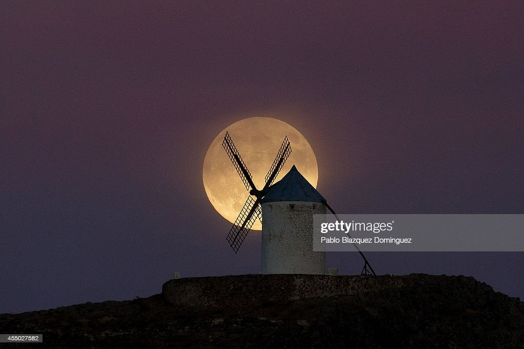 A moon appears behind a windmill a day before the supermoon is full on September 8, 2014 in Consuegra, in Toledo province, Spain. Consuegra belongs to a region made famous by the novel 'Don Quijote de la Mancha' (Don Quixote) writed by ' Miguel De Cervantes. Some of the windmills belong to the 16th century.