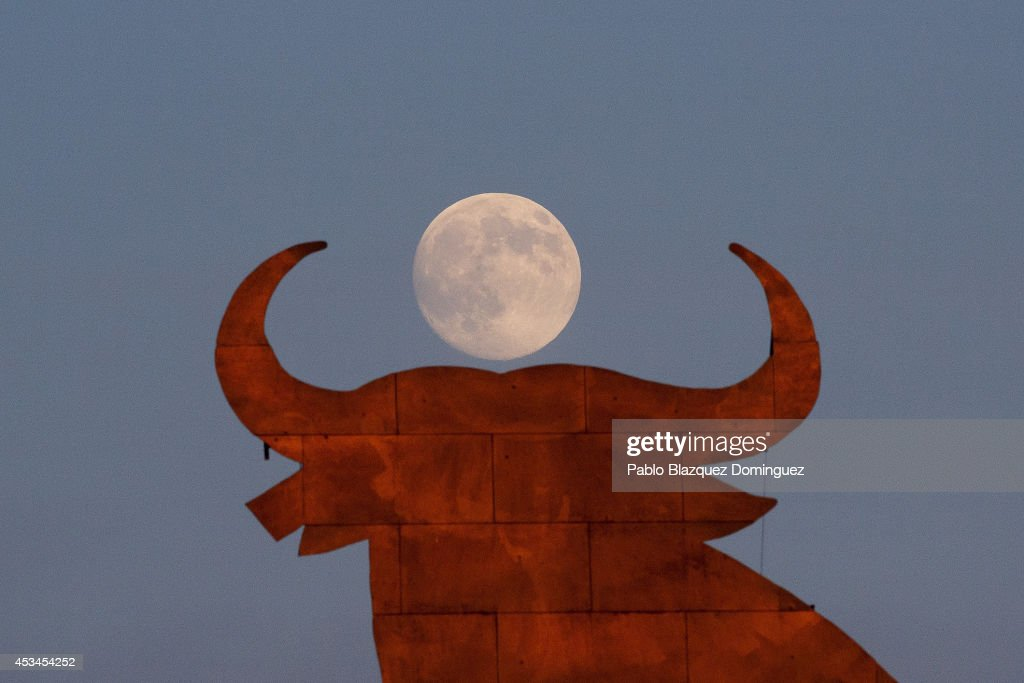 A moon appears behind the Toro Osborne advertisement a day before the supermoon is full on August 9, 2014 near Labajos, in Segovia province, Spain. In the second supermoon or perigee moon as it is also known of the summer, the moon will supposedly appear 30% brighter and 14% bigger than normal, with another due to appear in our skies on September 9, 2014.