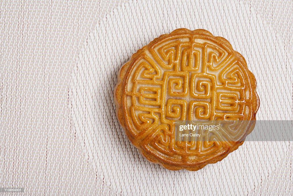 Moon Cake on a Geometric Place Mat : Stock Photo