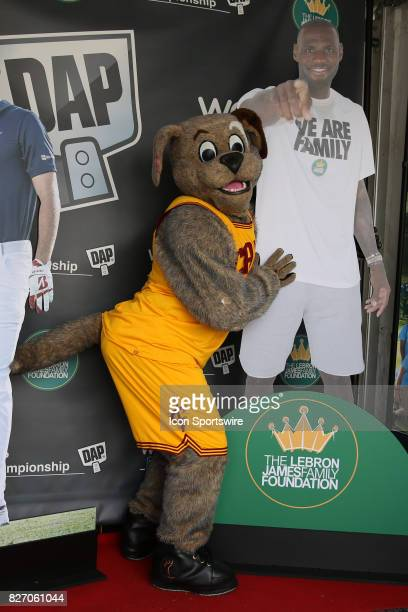 AKRON OH AUGUST 06 Moon Dog the Cleveland Cavaliers mascot poses with a LeBron James cardboard cut out in the Fan Zone during the final round of the...