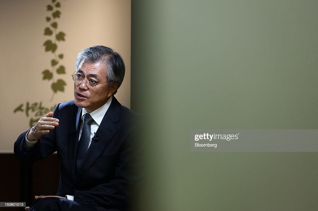 Moon Jae In, presidential candidate for South Korea's main opposition Democratic United Party, gestures as he speaks during an interview in Seoul, South Korea, on Tuesday, Oct. 9, 2012. South Korea's political opposition will unite behind a single candidate for president to stop the ruling party from winning a second five-year term in office, said Moon Jae In, the nominee for the Democratic United Party. Photographer: SeongJoon Cho/Bloomberg via Getty Images