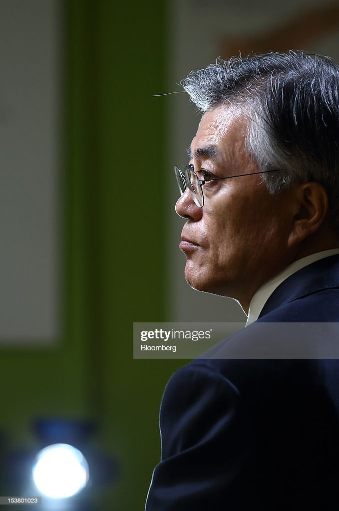 Moon Jae In, presidential candidate for South Korea's main opposition Democratic United Party, listens during an interview in Seoul, South Korea, on Tuesday, Oct. 9, 2012. South Korea's political opposition will unite behind a single candidate for president to stop the ruling party from winning a second five-year term in office, said Moon Jae In, the nominee for the Democratic United Party. Photographer: SeongJoon Cho/Bloomberg via Getty Images