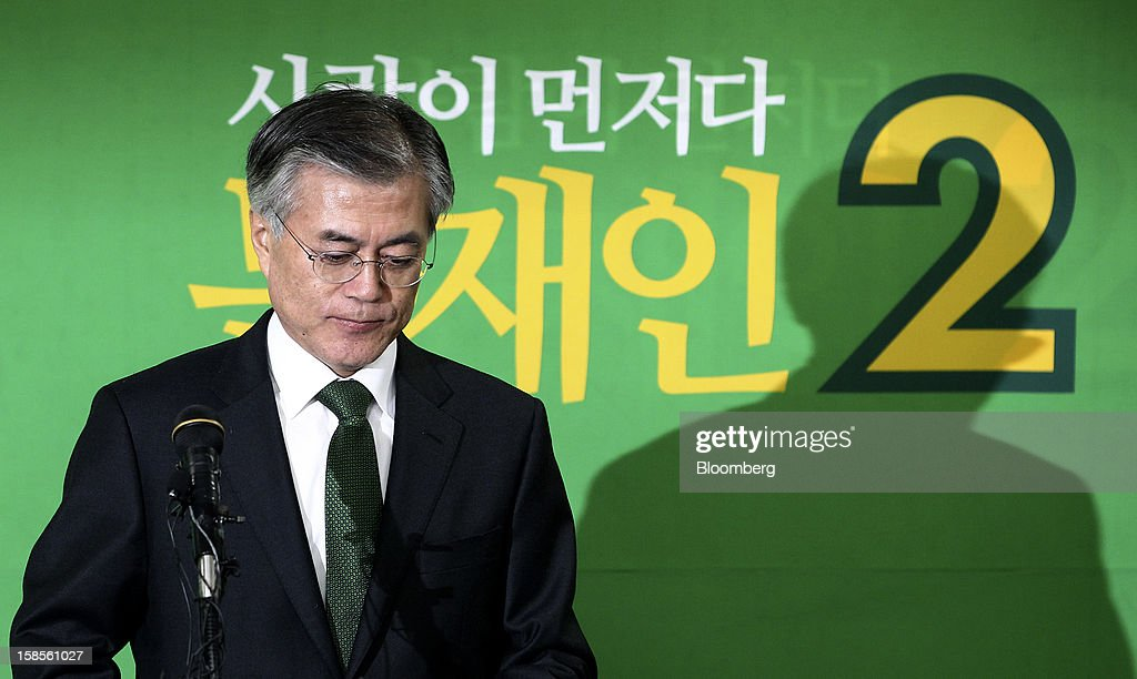 Moon Jae In, presidential candidate from the main opposition Democratic United Party, pauses during a press conference after learning Park Geun Hye, presidential candidate from the ruling New Frontier Party won the presidential election, at the party's headquarters in Seoul, South Korea, on Wednesday, Dec. 19, 2012. Moon, 59, conceded defeat, saying he was sorry he couldn't fulfill the expectations of his supporters. Photographer: SeongJoon Cho/Bloomberg via Getty Images