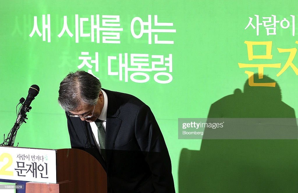 Moon Jae In, presidential candidate from the main opposition Democratic United Party, bows during a press conference after learning Park Geun Hye, presidential candidate from the ruling New Frontier Party won the presidential election, at the party's headquarters in Seoul, South Korea, on Thursday, Dec. 20, 2012. Moon, 59, conceded defeat, saying he was sorry he couldn't fulfill the expectations of his supporters. Photographer: SeongJoon Cho/Bloomberg via Getty Images