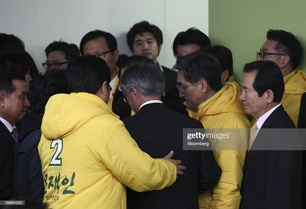 Moon Jae In, presidential candidate from the main opposition Democratic United Party, center, is surrounded by supporters as he leaves following a press conference after learning Park Geun Hye, presidential candidate from the ruling New Frontier Party won the presidential election, at the party's headquarters in Seoul, South Korea, on Thursday, Dec. 20, 2012. Moon, 59, conceded defeat, saying he was sorry he couldn't fulfill the expectations of his supporters. Photographer: SeongJoon Cho/Bloomberg via Getty Images