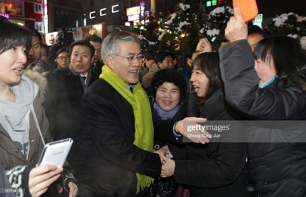 Moon Jae-In, presidential candidate of the main opposition Democratic United Party (DUP) takes to downtown streets as he begins his presidential election campaign on December 6, 2012 in Suwon, South Korea. South Korean will vote in the presidential election on December 19.