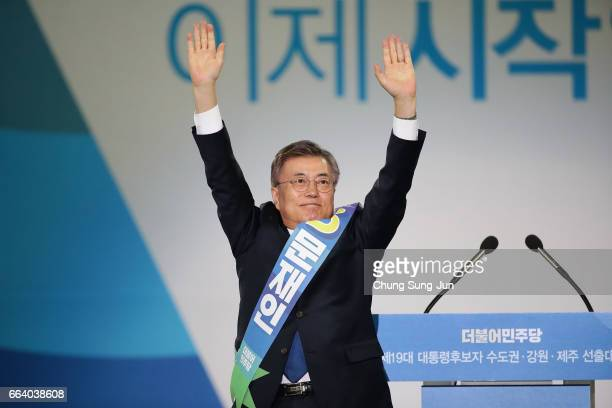 Moon JaeIn presidential election candidate for the Democratic Party of Korea celebrates during the primary election on April 3 2017 in Seoul South...