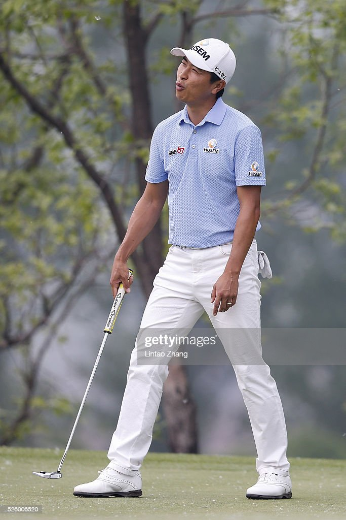 Moon Kyoungjun of Korea reacts after the plays a shot during the second round of the Volvo China open at Topwin Golf and Country Club on April 28, 2016 in Beijing, China.