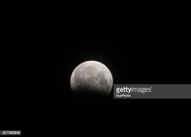 Moon looks in the sky at partial Lunar Eclipse time in the eastern Indian state Odisha's capital city Bhubaneswar on 7 August 2017