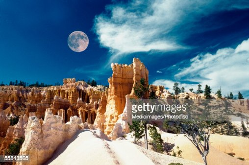 Moon over an arid landscape, Bryce Canyon National Park, Utah, USA : Stock Photo