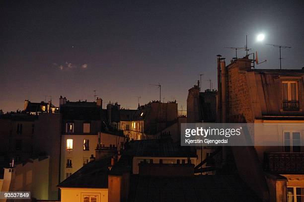 Moon over Parisian rooftops