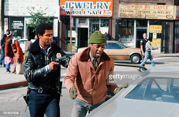 BLUES 'Moon Over Uranus' Episode 314 Pictured Michael Warren as Officer Bobby Hill Norman Alexander Gibbs as Smitty