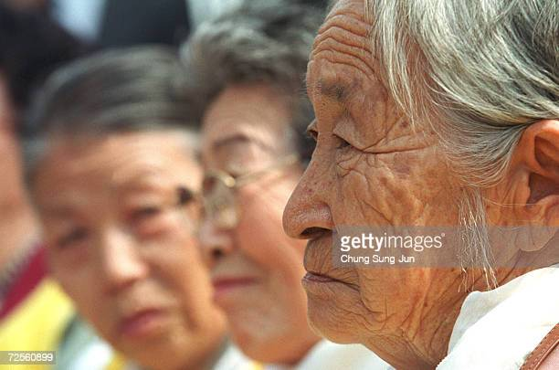 Moon PilKi a former World War II South Korean comfort woman attends a protest in front of the Japanese Embassy March 13 2002 during the 500th weekly...