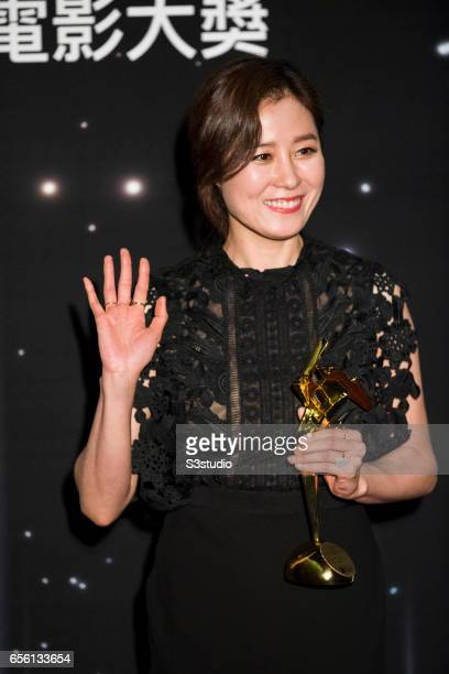 Moon Sori of Korea winner of the Best Supporting Actress award for 'The Handmaiden' poses with the award during the 11th Asian Film Awards on March...