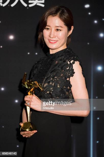 Moon Sori of South Korea winner of the Best Supporting Actress award for 'The Handmaiden' poses with the award during the 11th Asian Film Awards on...