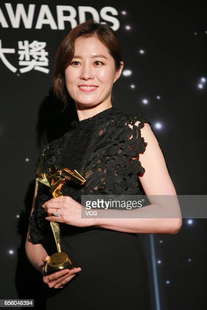 Moon Sori winner of the Best Supporting Actress award for film 'The Handmaiden' celebrates at the backstage of the 11th Asian Film Awards at Hong...