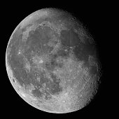Moon Waning Gibbous 87% phase against black night sky high resolution image