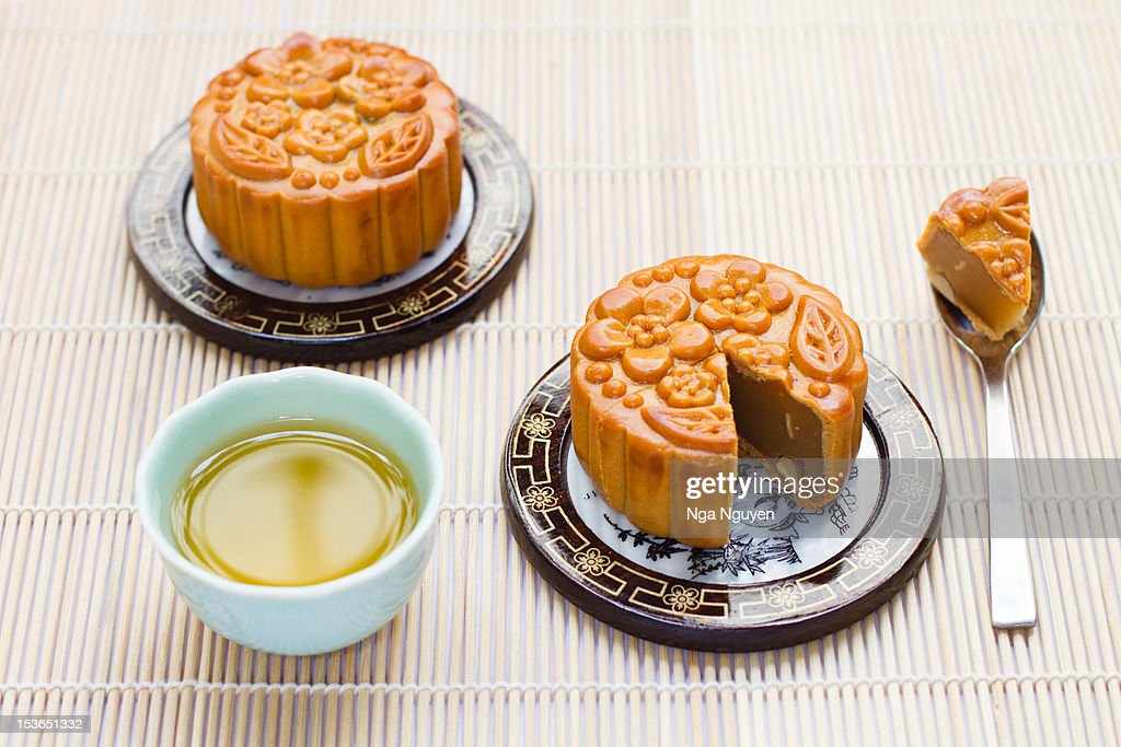 Mooncakes and green tea : Stock Photo