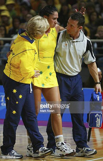 Mo'onia Gerrard of Australia is taken from the court with a knee injury during the netball test between Australia and New Zealand held at the Sydney...