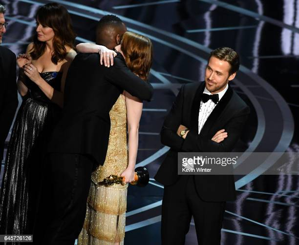 'Moonlight' actor Mahershala Ali hugs Emma Stone after it was discovered 'La La Land' was mistakenly announced as Best Picture onstage during the...