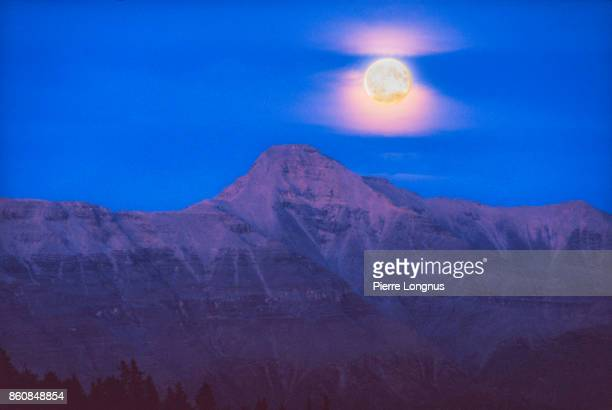 Moonlight over the Rocky Mountains of Muncho Lake  Provincial Park in the middle of the night along the Alaska Highway, British Columbia - Canada